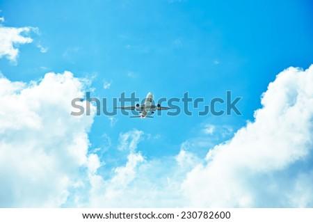 Airplane in the sky, descending, prepare for landing - stock photo