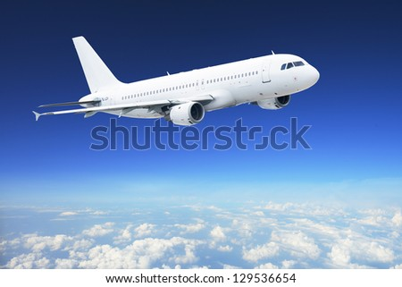 Airplane in the sky - Passenger Airliner / aircraft - stock photo