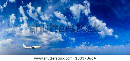 Airplane in the sky Passenger Airliner Aircraft - stock photo