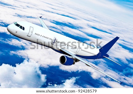 Airplane in the sky - Passenger Airliner / aircraft. Airplane on blue sky.Airplane over the mountains