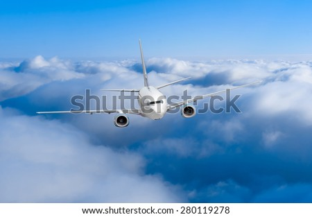 airplane in the sky. Passenger jet air plane flying on blue sky white clouds background
