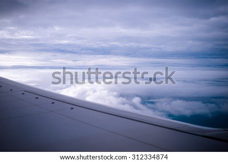 Airplane in the sky.tone film. - stock photo