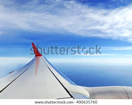 Airplane in the sky, view outside the window - stock photo