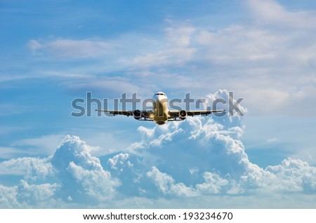 airplane in the sky with cloudy sky - stock photo