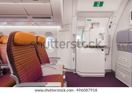 Airplane interior seats window and Emergency exit on an aircraft view from inside & Plane Door Inside Stock Images Royalty-Free Images \u0026 Vectors ... Pezcame.Com