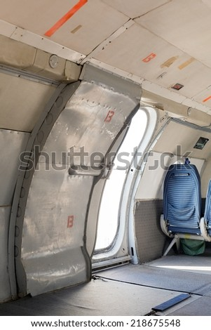 Airplane interior with seats - stock photo