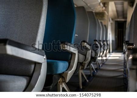 Airplane interior with seats closeup photo - stock photo