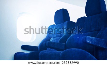 Airplane interior with sunlight - stock photo