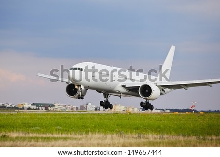 Airplane is landing on the airport - copy space  - stock photo