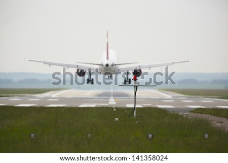 Airplane is landing on the airport - selective focus - stock photo