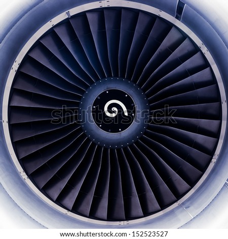 airplane jet engine turbine blades toned in blue