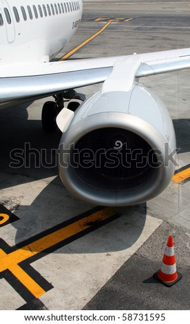 Airplane jet on the tarmac - stock photo