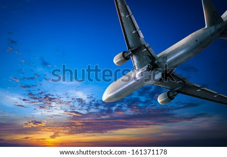 Airplane journey and sunset sky. Air traveling background, air jet with passengers flying to vacation trip - stock photo