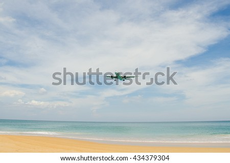 Airplane landing at airport, runway near the beach. - stock photo