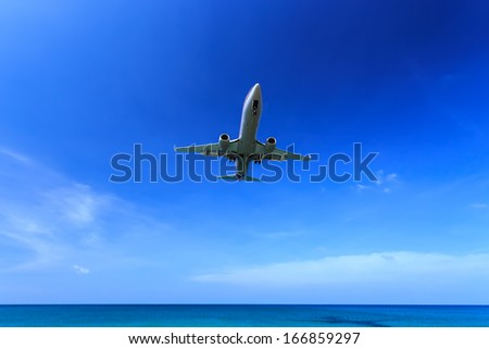 airplane landing in bright Blue sky, right before touch-down