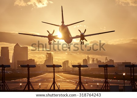 Airplane landing in sunset.