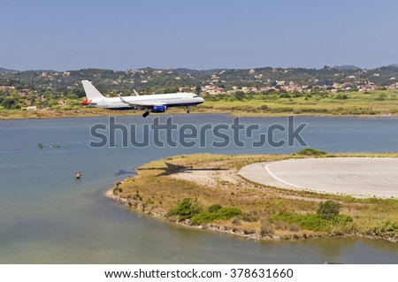 airplane landing on Corfu island Greece - stock photo