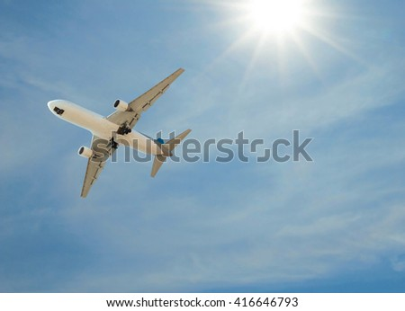 Airplane landing on sky blue sunny