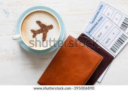 Airplane made of cinnamon in coffee.  Cup of coffee, passports and no name boarding passes. Traveling concept. Cappuccino in airport  - stock photo