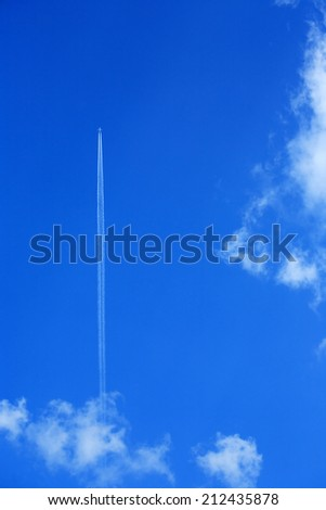 Airplane make vertical take-off against blue sky - stock photo