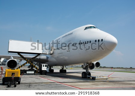 Airplane near the terminal in an airport cockpit - stock photo