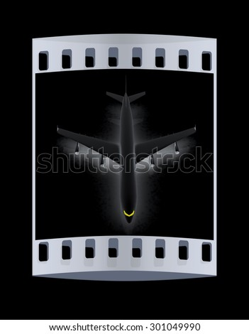 Airplane on a black background. The film strip