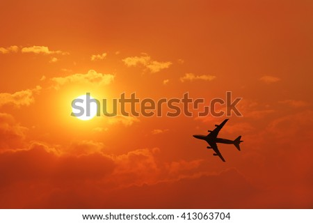 Airplane on a nice cloudy sunrise. silhouette airplane fly to the sun - stock photo