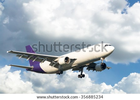 Airplane on blue sky - stock photo