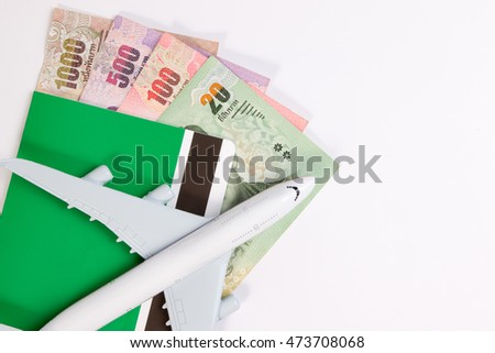 Airplane on Thai money, the rising costs of airline travel. Airline tickets or book bank isolated on white, top view.