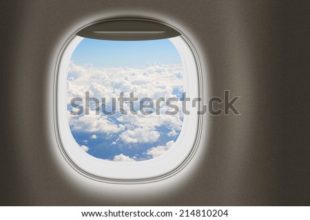 Airplane or jet window, travel and tourism concept. - stock photo