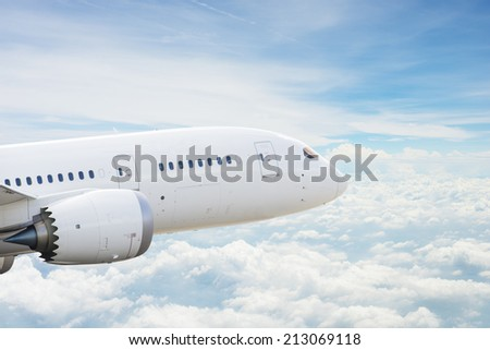 Airplane over clouds - stock photo