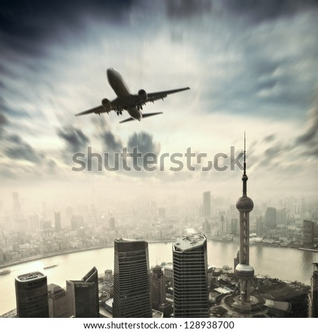 airplane over modern city