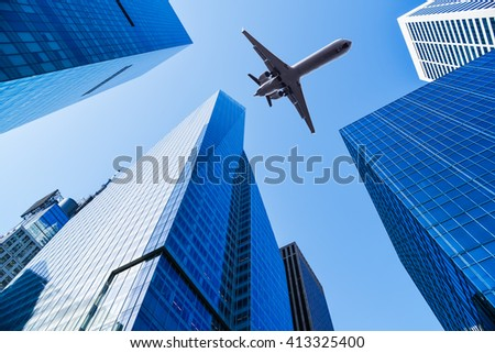 airplane over office buildings of new york - stock photo