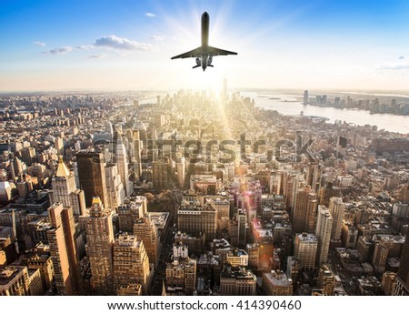 airplane over the skyline of manhattan - stock photo