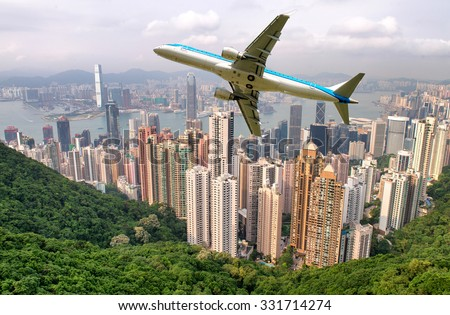 Airplane overflying Hong Kong. - stock photo