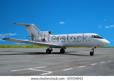 Airplane parked at airport. Small business jet. - stock photo