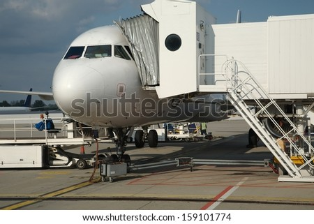 Airplane parked at an airport - stock photo