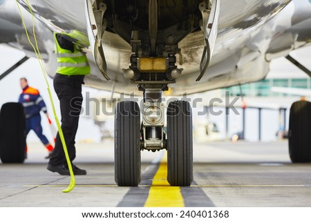 Airplane parked at the airport and preparation for next flight. - stock photo