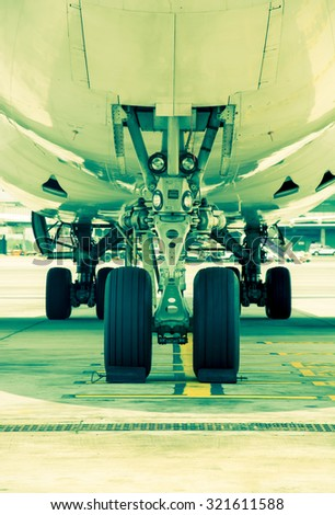 Airplane parked at the airport, vintage color style - stock photo