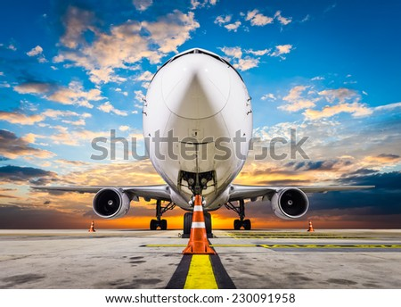 airplane parking with sunset - stock photo