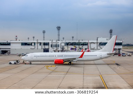 Airplane preparation by the ground crew before departure in airport - stock photo