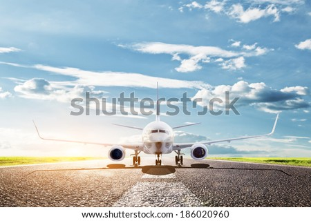 Airplane ready to take off from runway. A big passenger or cargo aircraft, airline. Transport, transportation, travel - stock photo