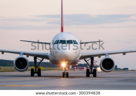 Airplane ready to take off from runway. A big passenger or cargo aircraft, airline. Transport, transportation, travel. - stock photo