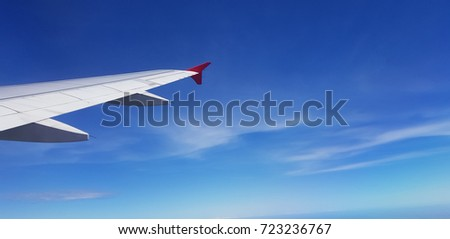 Airplane's wing in the clear blue sky