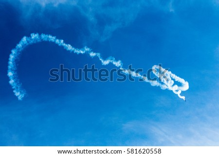 Airplane scribbling in the sky