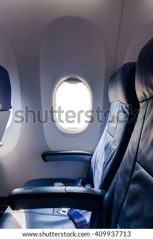 Airplane seat with white empty window.