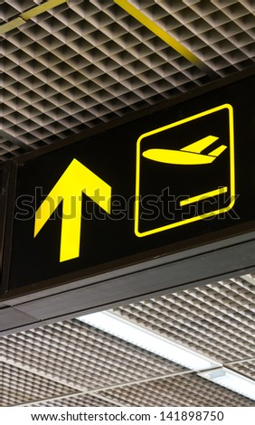 airplane sign and arrow - stock photo