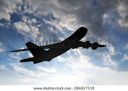 Airplane silhouette in the sunset - stock photo