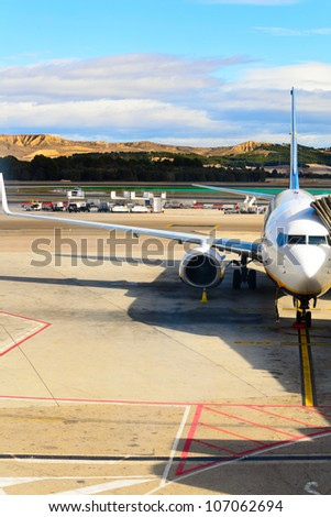 airplane standing on field at Barajas, Madrid, Spain - stock photo
