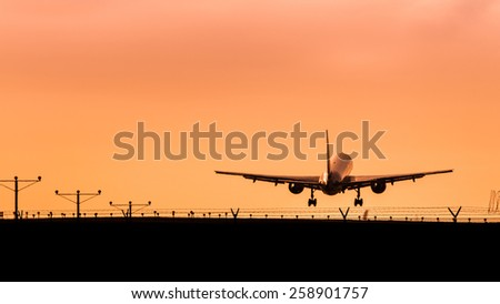Airplane Taking Off at Sunset
